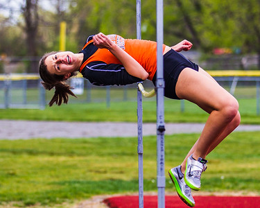Lucia Grigoli high jumps against Framingham in April 2012