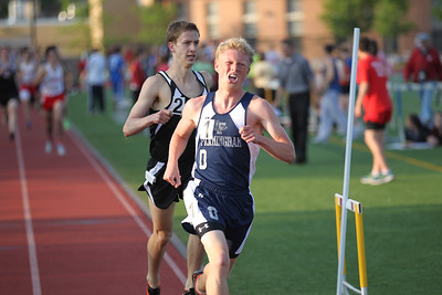 Ben Groleau of Framingham wins the 1 mile at the Bay State Conference Championship over Newton's Justin Keefe in 5:16.34.