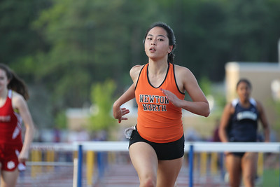 Kayla Wong of Newton North wins the Bay State Conference Championship.