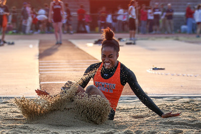 Carla Forbes wins the Bay State Conference Long Jump Championship.
