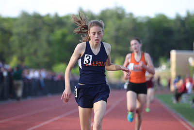 Gina Conti of Walpole wins the 1 mile at the Bay State Conference Championship in 5:16.62