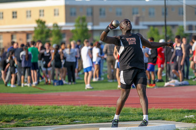 Swardiq Mayanja tosses the shot at the2012 Bay State Conference Championship