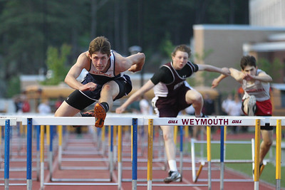 Connor McCarthy of Walpole wins the 110m Hurdles at the Bay State Conference Championship.