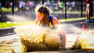 Randi Fries lands a long jump in the late afternoon sun at the D1 state championships.