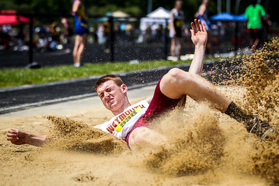 Tyler Mulcahy of Weymouth lands a long jump at the 2012 D1 Outdoor State Championships