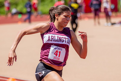 Arlington's Rebecca Robinson on her way to a 24.78 win in the 200m at the MSTCA Invitational in May.