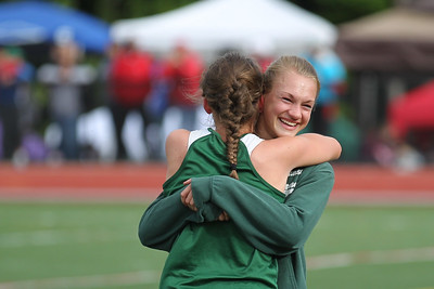 Laura Williamson is congratulated on her 800m win by high jump winner Amy Collins.