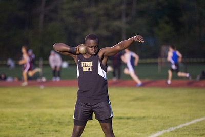 Swardiq Mayanja warms up for the 2012 Weston Twilight Meet