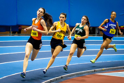 Amy Piccolo overcame a blistering early set pace by Newton North's Meghan Bellerose ot take the State Open 600m title.