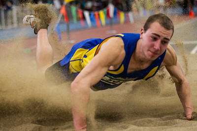 "Acton-Boxborough's Brian Sommers jumps to a 22'10.5"" MSTCA Elite Meet long jump title, just 1.75"" off the meet record."