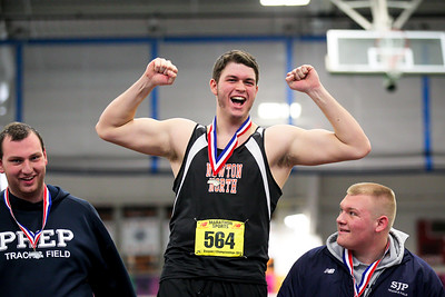 """Newton North's Carl Whitham won the shop put at the MIAA D1 Indoor Championships with a throw of 53' 4""""."""