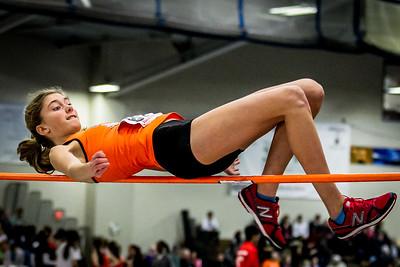 Newton North freshman Jess Hiltz high jumps vs. Brookline