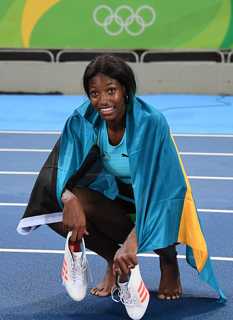 Shaunae Miller (BAH) wins gold in the women's 400m final during track and field competition in the Rio 2016 Summer Olympic Games at Estadio Olimpico Joao Havelange. Mandatory Credit: Kirby Lee-USA TODAY Sports