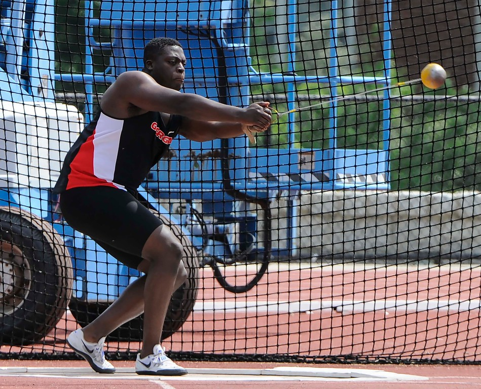 Georgia's Denzel Comenentia in the hammer event during the Georgia Invitational at the Spec Towns Track facility on Saturday, April 30, 2016 in Athens, Georgia. (Photo by John Kelley/UGA)