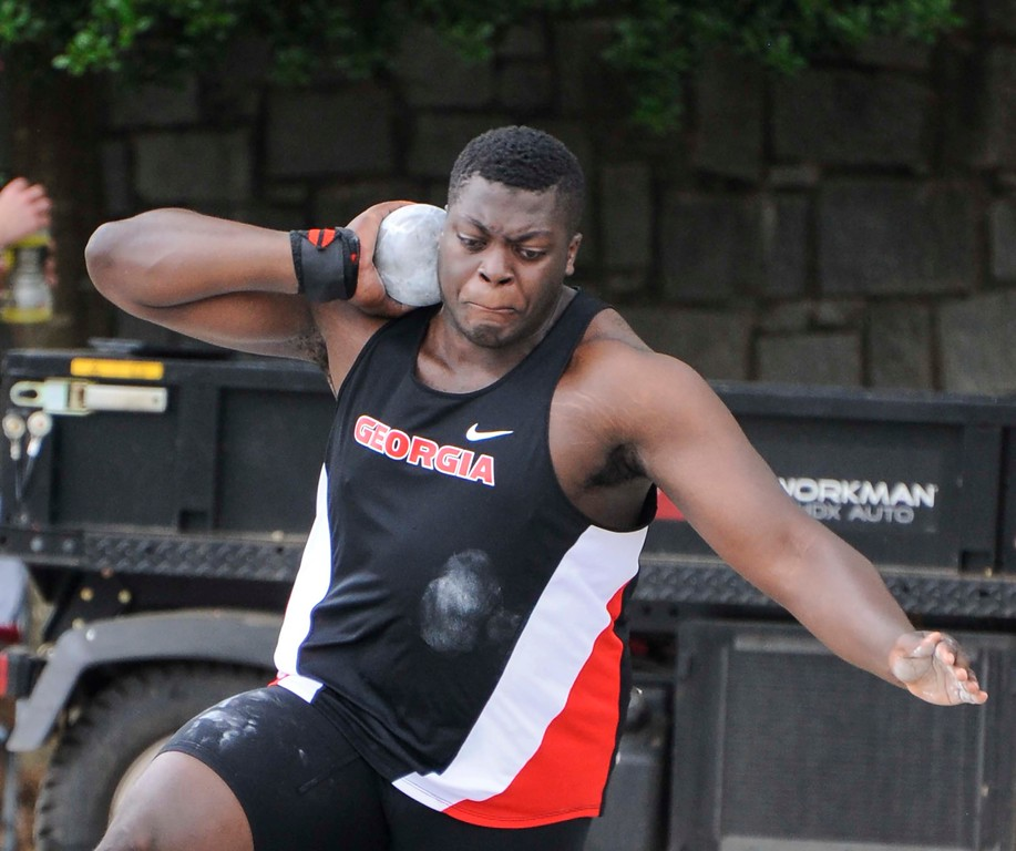 Georgia's Denzel Comenentia in the shot putt event during the Georgia Invitational at the Spec Towns Track facility on Saturday, April 30, 2016 in Athens, Georgia. (Photo by John Kelley/UGA)