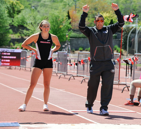 Georgia's Kate Hall and Georgia head coach Petros Kyprianou during the Spec Towns Invitational track meet at the Spec Towns Track Facility on Friday, April 7, 2017 in Athens, Ga. (Photo by John Kelley/ Georgia Sports Communication)
