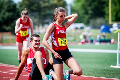 Andrew hold Sierra Irvin's blocks at the 2014 MIAA D2 Outdoor Championships