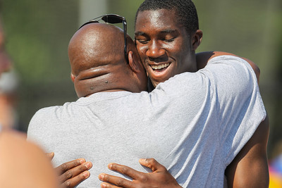 Boston College High School Junior Jordan Samuels is congratulated by his father on his State Open Triple Jump title.