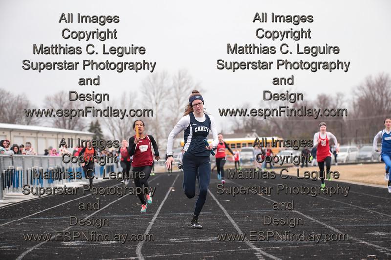 Carey's Addystin Lykins leads the field across the finish line in the girls 4x100 relay race. Willard's Niajha Walker in a close second. NB's Chloe Lanning, Arlington's Jacy Beach, Willard, Carey, Arcadia's Megan Mock, HL's Abbi Roerdink, Riverdale's Haley Frey.