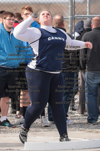 Carey's Lilly Adkins spins and throws the shot put for the Blue Devils.