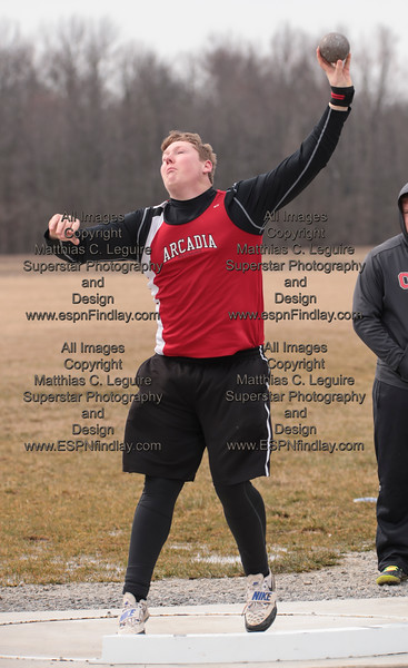 Arcadia's John Hill spins and tosses the shot put for the Redskins.