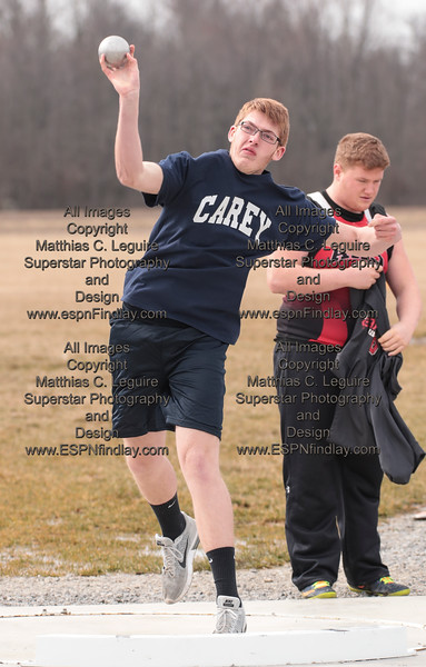 Carey's Chandler Brewer tosses the shot put 34' for the Blue Devils.