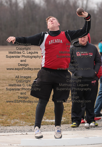 Arcadia's John Hill spins and tosses the shot put 41'6.5 for the Redskins.
