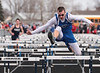 Riverdale's Stephen Letso easily clears the final hurdle in the boys 4x110m shuttle hurdle race ahead of Carey's Hayden Jacoby to lift the Falcons to victory over the Blue Devils in the first heat.