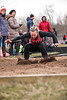 Arlington's Kindal Inbody leans forward as she lands in the long jump pit.