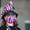 Woman wears a hat and mask. Scene on Oaks day at Churchill Downs, Louisville, KY on September 4, 2020. Photo: Rick Samuels