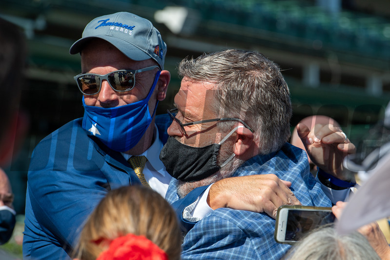 Owner Jason Loutsch hugs Dale Romans after Sittin On Go with Corey Lanerie wins Iroquois Stakes (G2) at Churchill Downs, Louisville, KY on September 5, 2020.