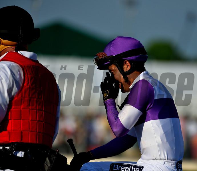 Mario Gutierrez wiping a tear away after winning the 142nd Kentucky Derby aboard Nyquist