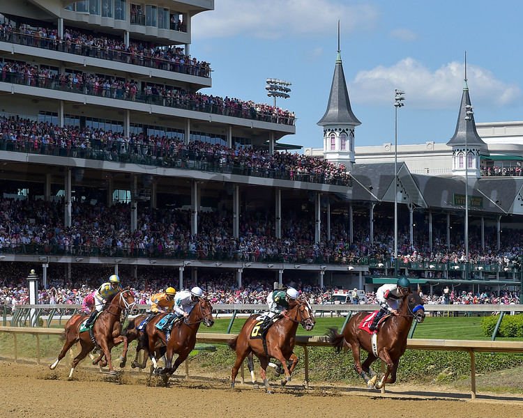 The field of the Alysheba (gr. II) rounds the first turn at Churchill Downs.