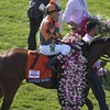 Lovely Maria after recieving the Garland of Lilies and Kerwin Clark showing a bit of emotion after winning the 141th Kentucky Oaks