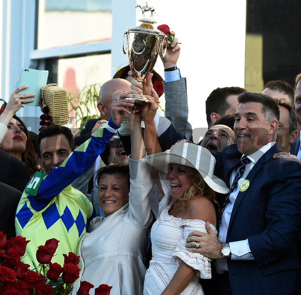 Jockey John Velazquez holds the winner's trophy aloft with the help of owner Vince Viola and Anthony Bonomo Sr. and their spouses as they celebrate winning the 143rd running of the Kentucky Derby May 6, 2017 in Louisville, Kentucky.  Photo by Skip Dickstein