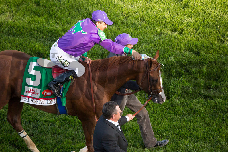 California Chrome with Victor Espinoza up wins the 140th running of the Kentucky Derby at Churchill Downs May 3, 2014. Photo by Mark Mahan