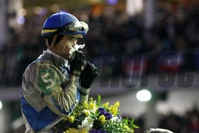Jockey Garrett Gomez celebrated winning the Breeders' Cup Classic (G. I) on Blame, overtaking favorite Zenyatta by a nose.