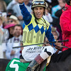 Jockey John Velazquez pumps his fist as he wins the 143rd running of the Kentucky Derby May 6, 2017 in Louisville, Kentucky.  Photo by Skip Dickstein