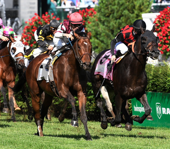 Divisidero with jockey Julien Leparoux up, left, out duels Beach Patrol with jockey Florent Geroux to the wire to win the 31st running of the Woodford Reserve Turf Classic May 6, 2017 at Churchill Downs in Louisville, Kentucky.  Photo by Skip Dickstein