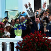 Jockey John Velazquez sprays champagne over the celebrants after winning the 143rd running of the Kentucky Derby May 6, 2017 in Louisville, Kentucky.  Photo by Skip Dickstein