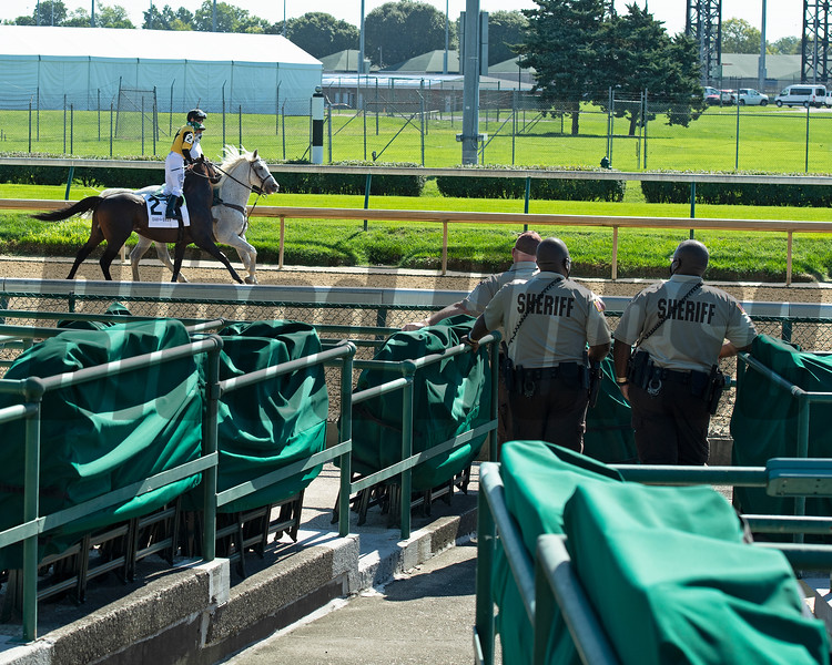 Sheriffs watch as horses warm up for a race. Scenes at Churchill Downs, Louisville, KY on September 5, 2020.