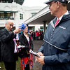Gary Barber jokes with Winstar's Kenny Troutt in the paddock before the running of Funny Cide at Churchill Downs on Derby Day on May 4, 2019 in Louisville, Ky. Photo: Arden Barnes