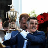 Owner Vince Viola holds the winner's trophy aloft after his horse Always Dreaming won the 143rd running of the Kentucky Derby May 6, 2017 in Louisville, Kentucky.  Photo by Skip Dickstein