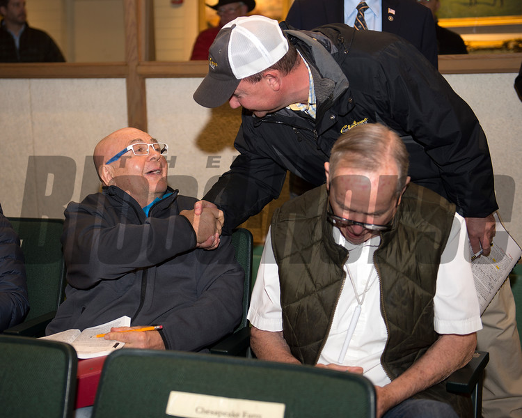 Buyer Charles Fipke congratulated by Bradley Purcell from Claiborne as R.J. Bennett right signs ticket<br /> Hip 526 filly by Speightstown from Nikkis Smartypants and Bedouin Bloodstock bought for 390,000 by John Moynihan<br /> Keeneland November Sales on Nov. 10, 2016, in Lexington, Ky.