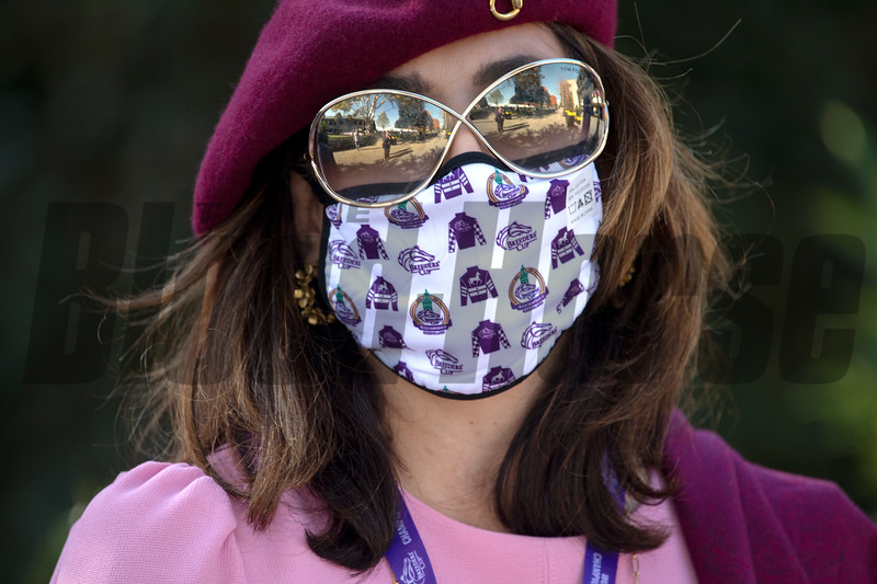 Woman wears a Breeders' Cup mask at Keeneland in Lexington, Ky. on Nov. 7, 2020.