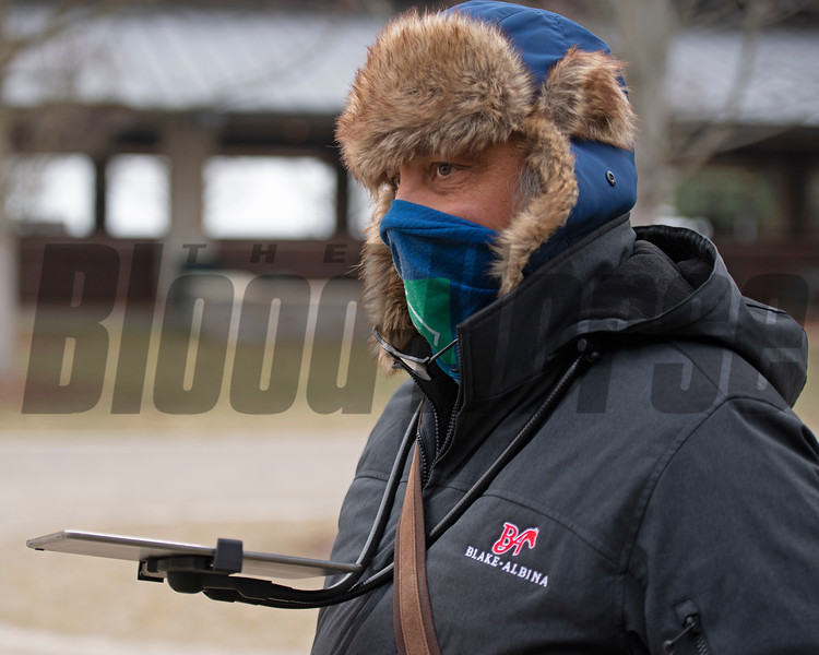 Ron Blake with Blake - Albina bloodstock looks at horses and utilizes a hands-free ipad setup with stylus to work more effciently during cold weather. <br /> Keeneland January Sales at Keeneland near Lexington, Ky., on Jan. 11, 2021.