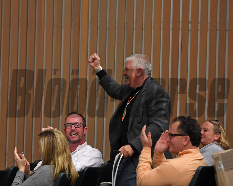 Artist Andre Pater celebrates the sale of Lot 131 Red Arrow.<br /> Keeneland sport art auction at Keeneland in Lexington, Ky., on Nov. 21, 2016, in Lexington, Ky.