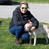 Caption: Meredith Daugherty with Dixie, Kelly Wheeler's dog in the Rice Road barn area.<br /> Behind the Scenes at Keeneland during Covid19 virus and the people, horses, and essentials needed to take care of race horses on April 2, 2020 Keeneland in Lexington, KY.