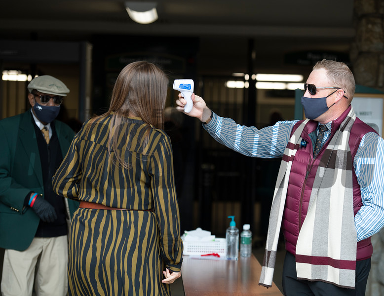 taking temperature at entry<br /> Scenes at Keeneland  on October 3, 2020.