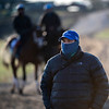 Trainer Brad Cox is all covered up to avoid the below freezing temperatures at Keeneland Race Course Monday Nov. 2 2020 in Lexington, KY.  Photo by Skip Dickstein